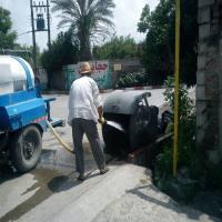 شستشوی سطل های  زباله  سطح شهر دابودشت